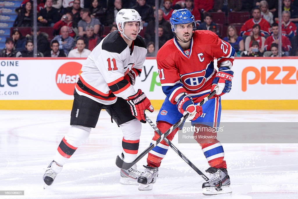 Brothers Brian Gionta #21 of the Montreal Canadiens and Stephen Gionta #11 of the New Jersey Devils skate during the NHL game at the Bell Centre on January 27, 2013 in Montreal, Quebec, Canada.
