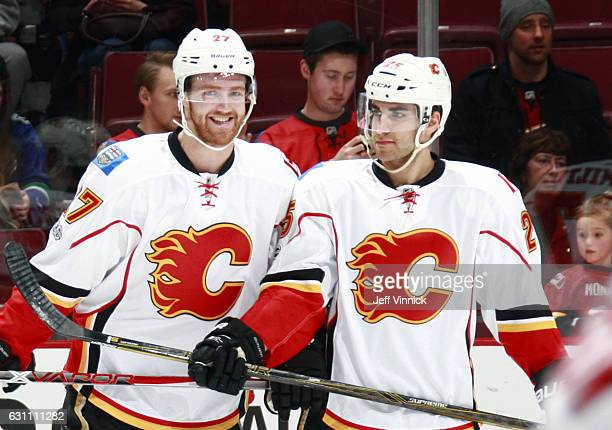 Brothers Dougie Hamilton and Freddie Hamilton of the Calgary Flames skate together during warmup before their NHL game against the Vancouver Canucks...