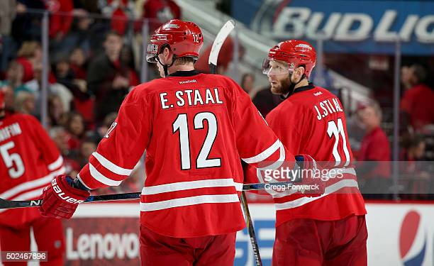 Brothers Eric Staal and Jordan Staal of the Carolina Hurricanes skate back to the bench after a called time out during a NHL game against the...