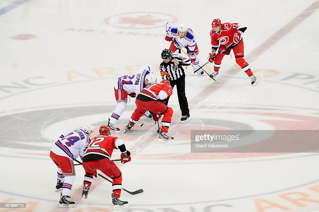 Brothers <a gi-track='captionPersonalityLinkClicked' href=/galleries/search?phrase=Eric+Staal&family=editorial&specificpeople=202199 ng-click='$event.stopPropagation()'>Eric Staal</a> #12, <a gi-track='captionPersonalityLinkClicked' href=/galleries/search?phrase=Jordan+Staal&family=editorial&specificpeople=533044 ng-click='$event.stopPropagation()'>Jordan Staal</a> #11 and Jared Staal #13 of the Carolina Hurricanes take the ice for the opening faceoff agaist of the New York Rangers at PNC Arena on April 25, 2013 in Raleigh, North Carolina.