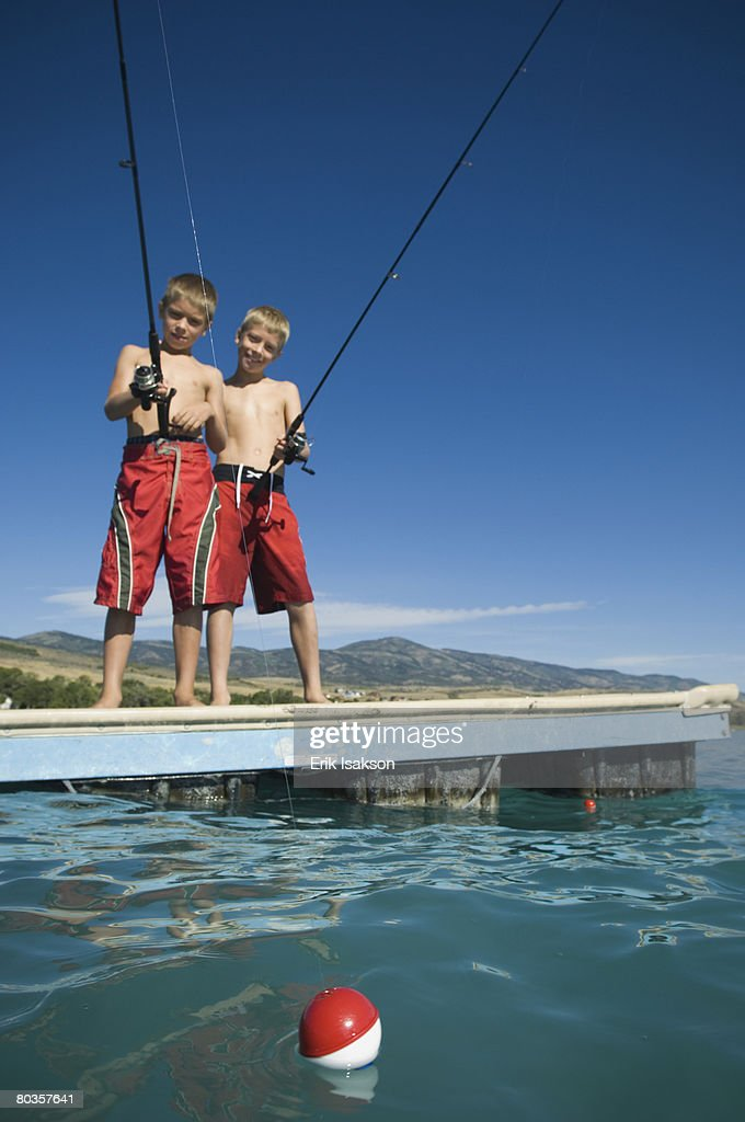 Brothers fishing off dock in lake utah united states stock for What age do you need a fishing license