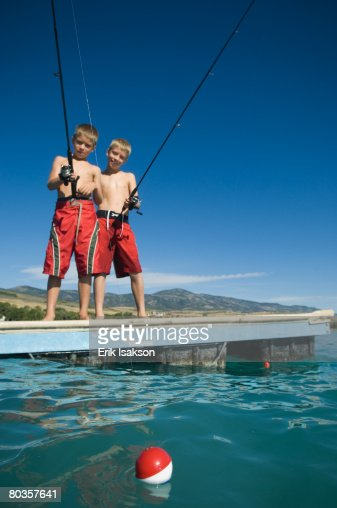 Brothers fishing off dock in lake utah united states stock for Fishing off a pier