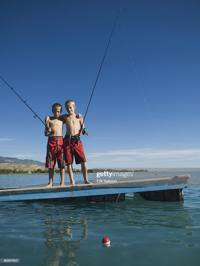 Brothers fishing off dock in lake utah united states stock for Utah fishing license cost