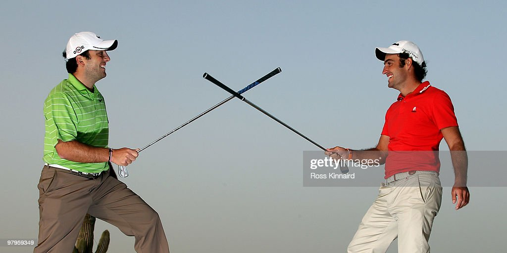 Brothers, <a gi-track='captionPersonalityLinkClicked' href=/galleries/search?phrase=Francesco+Molinari&family=editorial&specificpeople=637481 ng-click='$event.stopPropagation()'>Francesco Molinari</a> and Edoardo Molinari of Italy sword fighting with a golf club after a practice round prior to The Comercialbank Qatar Masters at The Doha Golf Club on January 26, 2010 in Doha, Qatar.