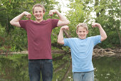 Two brothers enjoy good natured competition while having fun in the great outdoors.