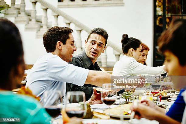 Brothers in discussion during family dinner party