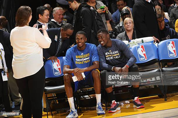 Brothers Justin Holiday of the Golden State Warriors chats with Jrue Holiday of the New Orleans Pelicans prior to the game on December 4 2014 at...