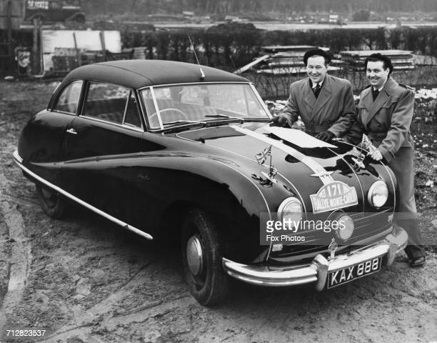 Brothers Laurie and Bert Leader stand beside their Austin A90 Atlantic sports coupe before the start of the Monte Carlo Rally on 16 January 1953 at...