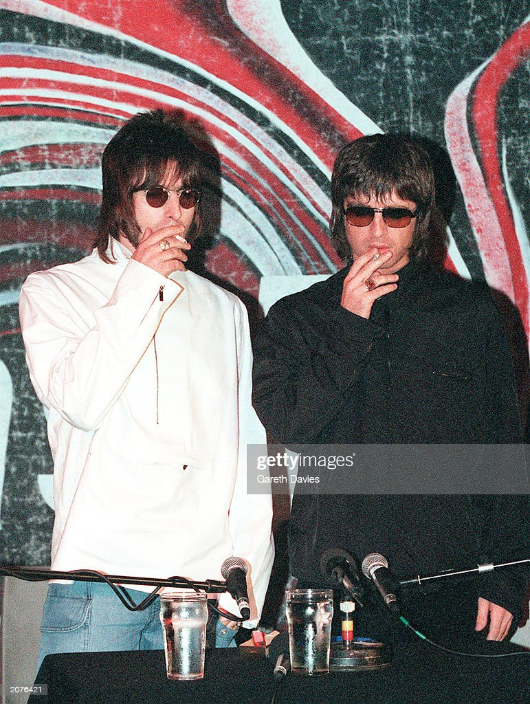 Brothers Liam (L) and Noel (R) Gallagher from Oasis at a press conference held in the Waterrats pub in London, August 25, 1999. The conference was called to announce the departure of the bands two founding member Guigsy and Bonehead, who were replaced by Gem Archer and Andy Bell.