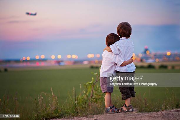 Brothers looking at an airplane