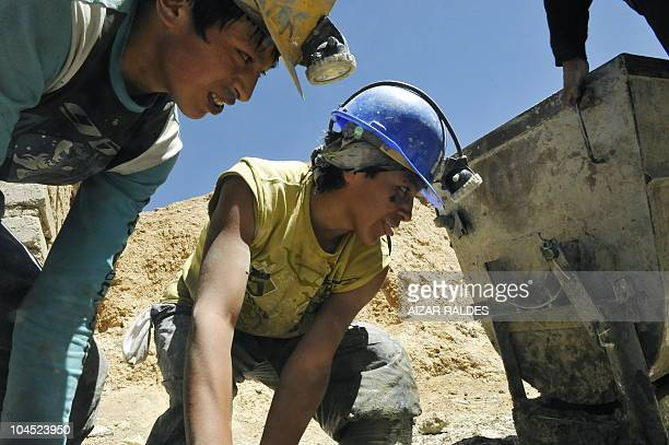 Brothers Luis and Vladimir Menacho 15 and 16 years old respectively work at the mine entrance in Cerro Rico hill in Potosi Bolivia September 15 2010...