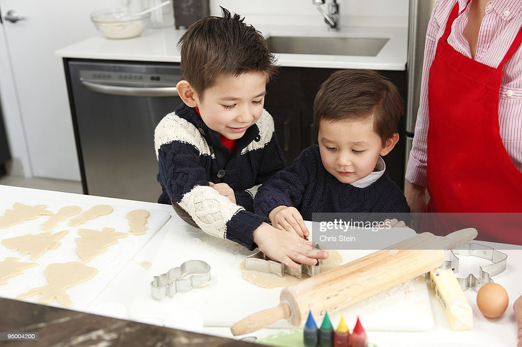 Brothers making cookies : Stock Photo