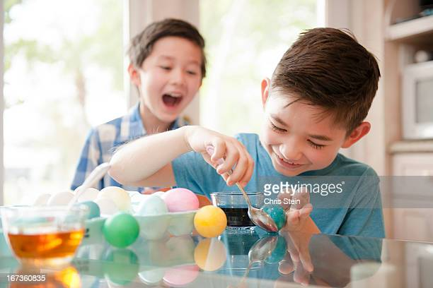 Brothers Making Easter Eggs