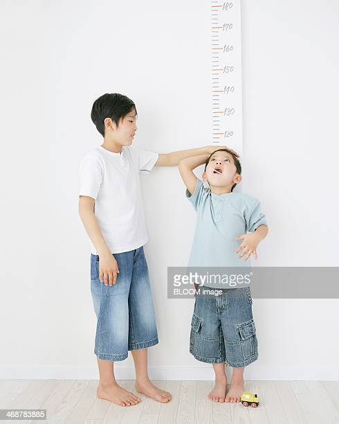 Brothers Measuring Height