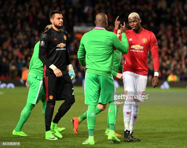 Brothers Paul Pogba of Manchester United and Florentin Pogba of SaintEtie speak prior to the UEFA Europa League Round of 32 first leg match between...