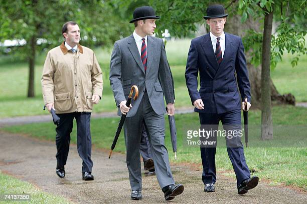 Brothers Prince William and Prince Harry in suits and traditional bowler hats with umbrellas attend the Combined Cavalry Old Comrades Association...