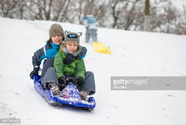 Brothers ride down slope together