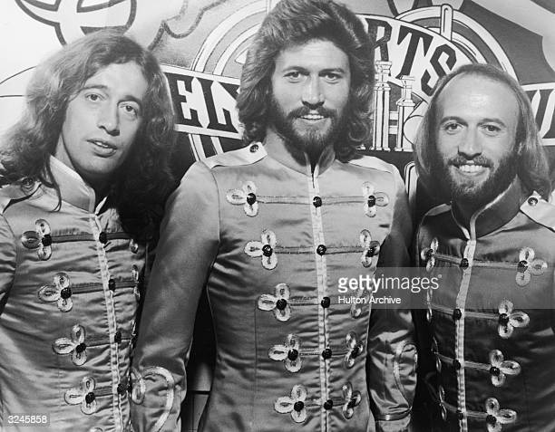Brothers Robin Barry and Maurice Gibb of the Australian rock and roll group the Bee Gees smile in their costumes in a promotional portrait for...