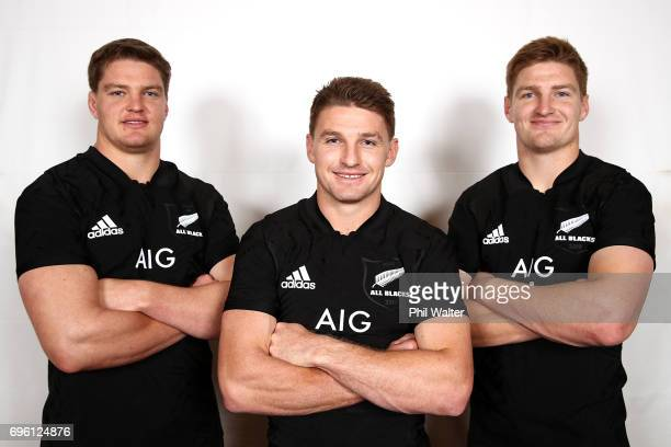 Brothers Scott Barrett Beauden Barrett and Jordie Barrett pose following a New Zealand All Blacks team photo session on June 15 2017 in Auckland New...