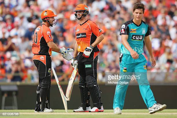Brothers Sean Marsh and Mitch Marsh of the Scorchers talk after a boundary during the Big Bash League match between the Perth Scorchers and the...