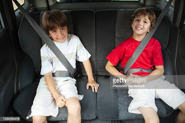 Brothers sitting in car, portrait