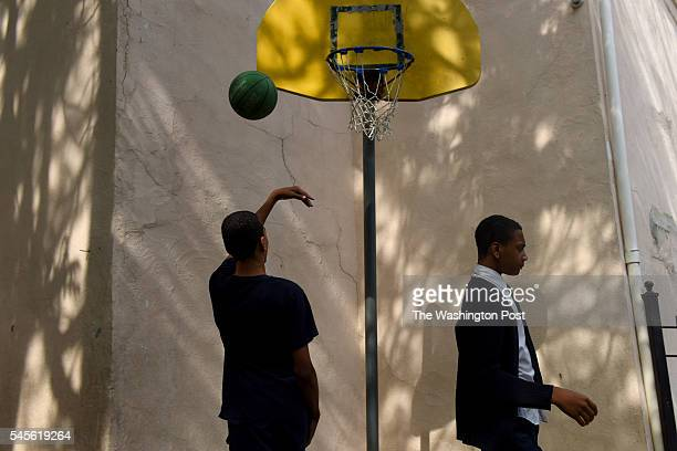 WASHINGTON DC MAY 11 Brothers Terrance Webster Jr right and Terrell Webster played basketball at the Kingman Boys and Girls Club in Washington DC's...