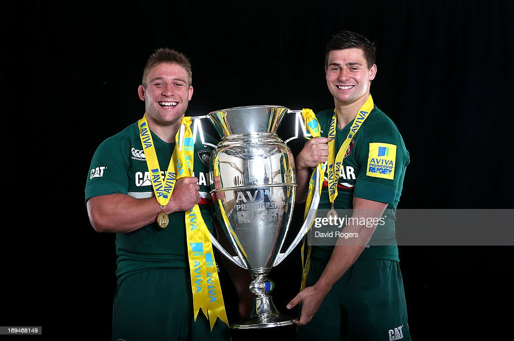 Brothers Tom Youngs and <a gi-track='captionPersonalityLinkClicked' href=/galleries/search?phrase=Ben+Youngs&family=editorial&specificpeople=3970947 ng-click='$event.stopPropagation()'>Ben Youngs</a> of Leicester poses with trophy following his team's 37-17 during the Aviva Premiership Final between Leicester Tigers and Northampton Saints at Twickenham Stadium on May 25, 2013 in London, England.
