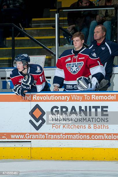 Brothers Ty Comrie and Eric Comrie of the Tri City Americans stand on the bench against the Kelowna Rockets on February 19 2014 at Prospera Place in...