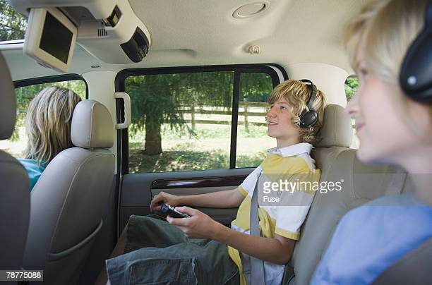 Brothers Watching DVD in Back Seat of Car