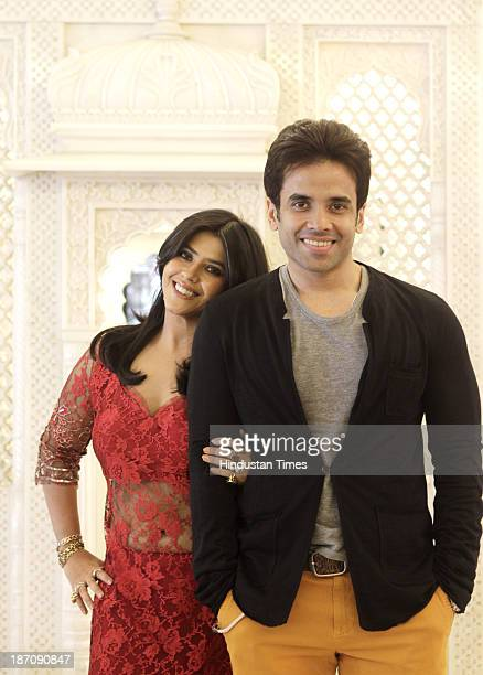 Brothersister duo Ekta Kapoor and Tusshar Kapoor pose for the photograph during the Diwali at Juhu on November 2 2013 in Mumbai India