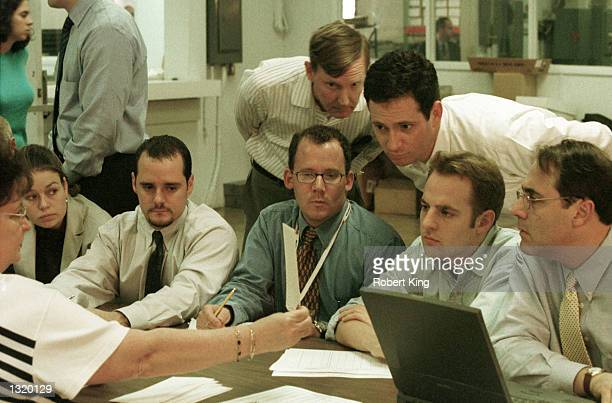 Broward County Election employees reporters and Judicial Watch members look at undervotes December 18 2000 at the Broward County Elections warehouse...