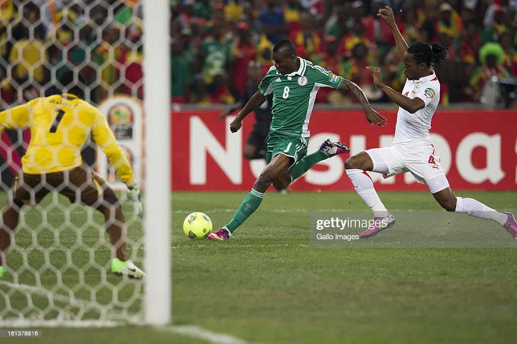 Brown Aide Ideye of Nigeria (C) and Bakary Kone of Burkina Faso (R) in action during the 2013 Orange African Cup of Nations Final match between Nigeria and Burkina Faso from the National Stadium on Feburary 10, 2013 in Johannesburg, South Africa.