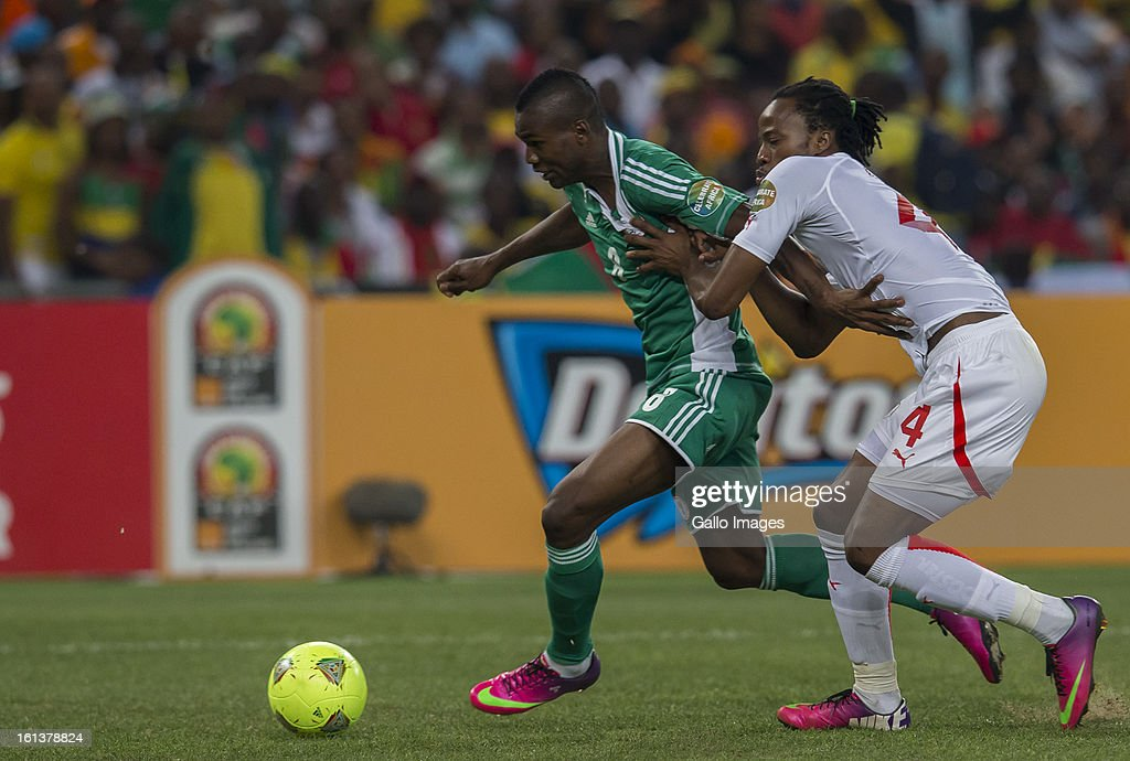 Brown Aide Ideye of Nigeria (L) and Bakary Kone of Burkina Faso (R) in action during the 2013 Orange African Cup of Nations Final match between Nigeria and Burkina Faso from the National Stadium on Feburary 10, 2013 in Johannesburg, South Africa.