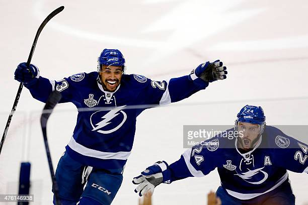 T Brown and Ryan Callahan of the Tampa Bay Lightning celebrate a first period goal by Cedric Paquette against the Chicago Blackhawks during Game Two...