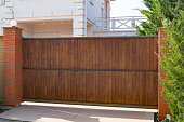 Brown automatic wooden gates of private house
