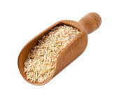 Brown Basmati Wild Rice in a Wooden Scoop. Basmati is a variety of long, slender grain aromatic rice traditionally from India and Pakistan. The image is a cut out, isolated on a white background, with
