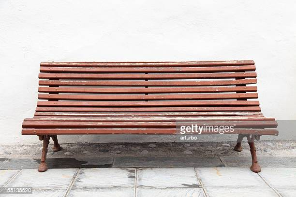 brown bench against house facade