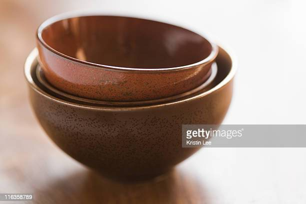 Brown bowls stacked together