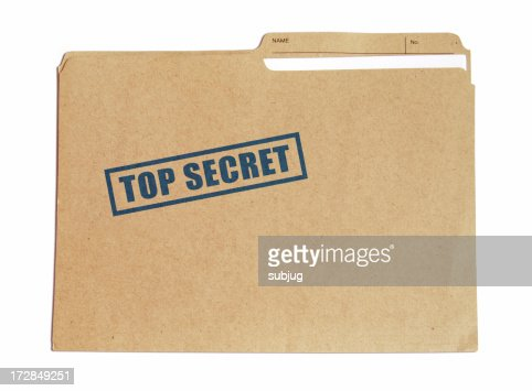 Brown card folder with top secret stamped on it in blue