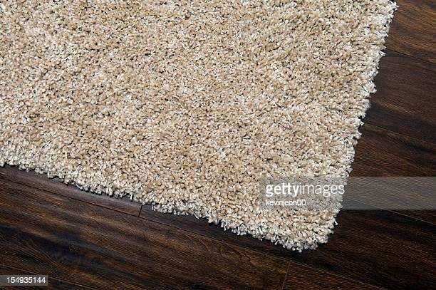 A brown carpet on a wooden floor