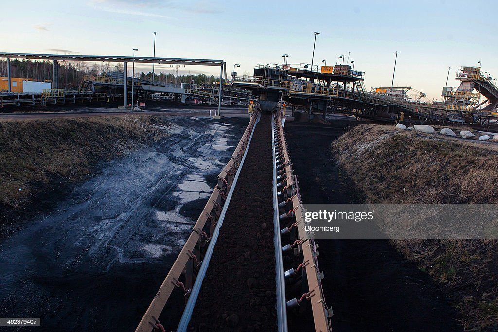 Brown coal travels along a conveyor belt at a lignite mine operated by Vattenfall AB in Welzow-Sued, Germany, on Saturday, Jan. 11, 2014. Across the continent's mining belt, from Germany to Poland and the Czech Republic, utilities such as Vattenfall AB, CEZ AS and PGE SA are expanding open-pit mines that produce lignite. Photographer: Krisztian Bocsi/Bloomberg via Getty Images