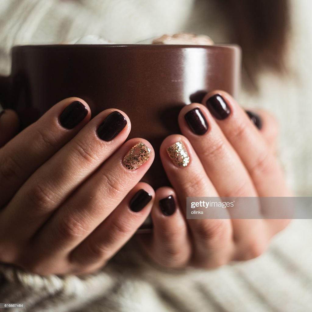 Brown cup with cocoa and marshmallow in the hands : Stock Photo