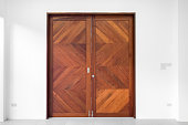 Brown double wood door on white wall background