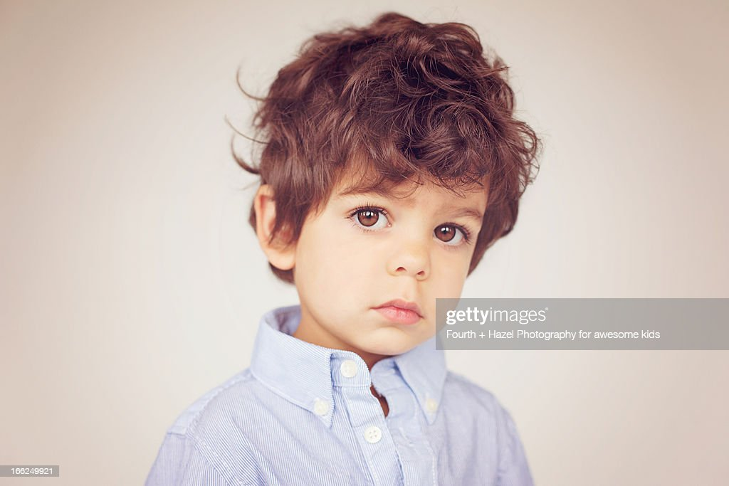 brown eyed boy with curly hair stock photo getty images
