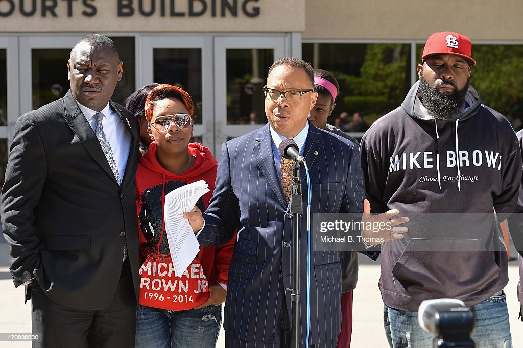 Brown family attorney, Benjamin L. Crump speaks to the media along with <a gi-track='captionPersonalityLinkClicked' href=/galleries/search?phrase=Lesley+McSpadden&family=editorial&specificpeople=13486871 ng-click='$event.stopPropagation()'>Lesley McSpadden</a> (L) and <a gi-track='captionPersonalityLinkClicked' href=/galleries/search?phrase=Michael+Brown+Sr.+-+Father+of+Shooting+Victim+Michael+Brown&family=editorial&specificpeople=13759040 ng-click='$event.stopPropagation()'>Michael Brown Sr.</a> (R) during a press conference outside the St. Louis County Court Building on April 23, 2015 in Clayton, Missouri. Family members have announced a civil lawsuit over the death of Michael Brown Jr. this past August in Ferguson, Missouri. (Photo by Michael B. Thomas/Getty Images) Local Caption: Benjamin L. Crump