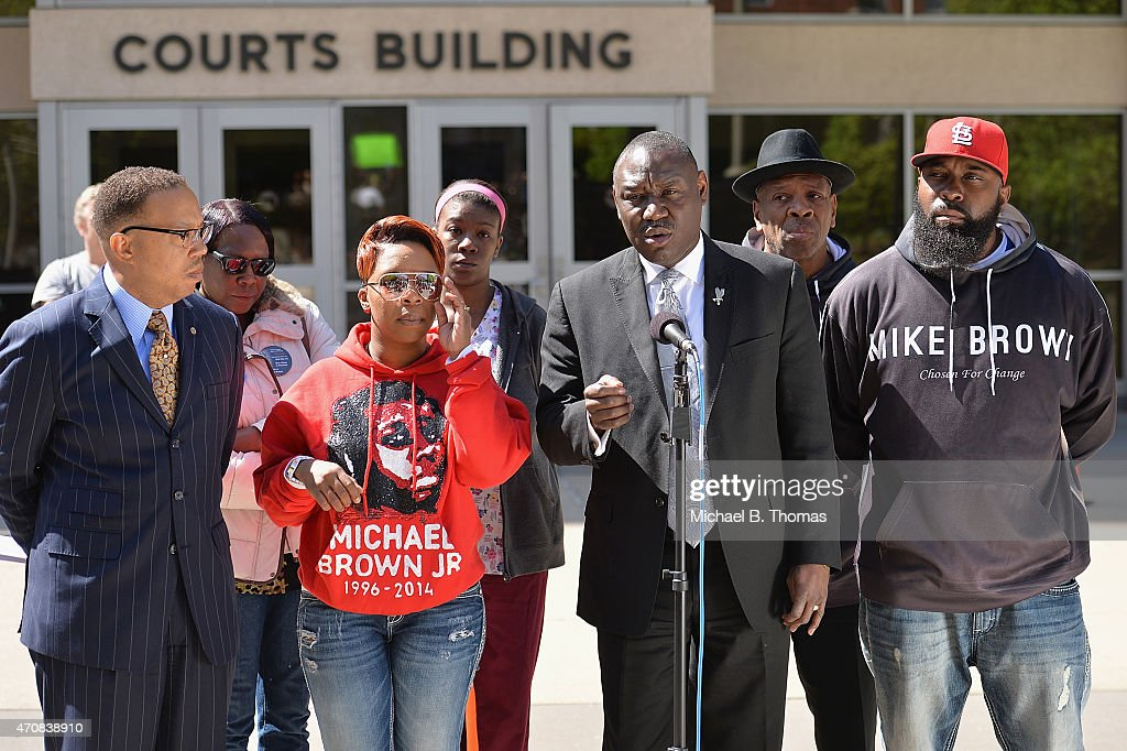 Brown family attorney, Benjamin L. Crump speaks to the media along with Lesley McSpadden (L) and Michael Brown Sr. (R) during a press conference outside the St. Louis County Court Building on April 23, 2015 in Clayton, Missouri. Family members have announced a civil lawsuit over the death of Michael Brown Jr. this past August in Ferguson, Missouri. (Photo by Michael B. Thomas/Getty Images) Local Caption: Benjamin L. Crump
