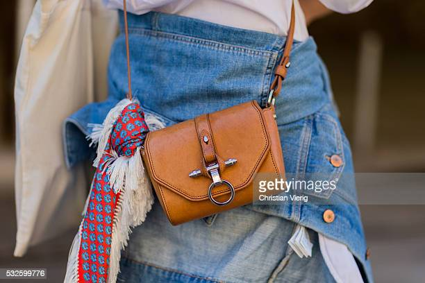 A brown Givenchy bag with scarf at MercedesBenz Fashion Week Resort 17 Collections at Carriageworks on May 19 2016 in Sydney Australia