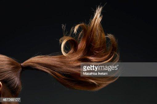 Brown hair fluttering