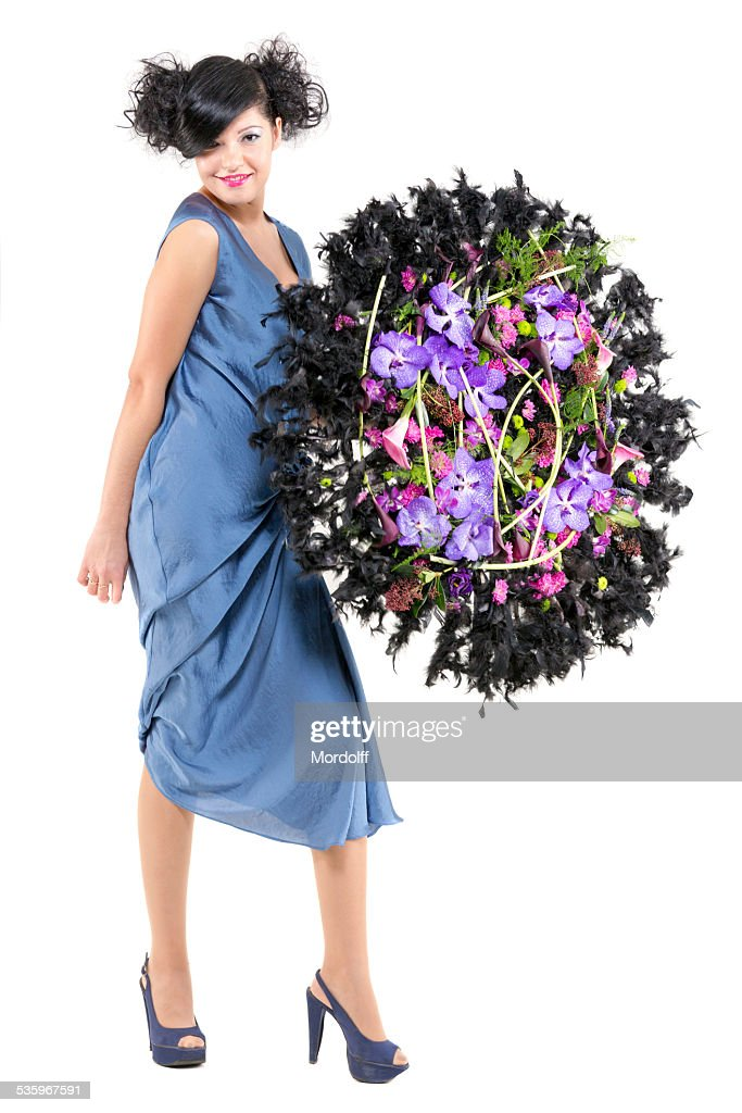 Brown haired young woman with floral composition : Stock Photo