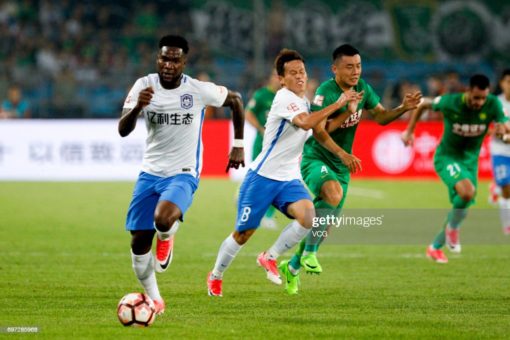 Brown Ideye # 39 of Tianjin Teda controls the ball during the 13th round match of 2017 Chinese Football Association Super League (CSL) between Beijing Guoan and Tianjin Teda at Beijing Workers' Stadium on June 18, 2017 in Beijing, China.